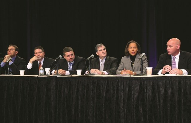 In the heat of the debate are (L–R): Joe Amendola, Bart Carpenter, Luis Garcia, Ron Reahard, Heather Haynes and Tony Dupaquier. Not pictured: moderator Kevin Jacobs.
