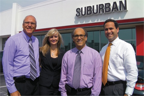 (L-R): Steve Veldkamp, Jodi Nicholson, Raymond Borg and Gary Allgeier on one of The Suburban Collection's lots.