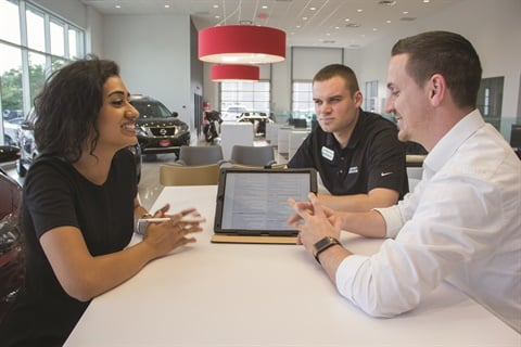 This is the typical scene at any one of Bernie Moreno Companies' 15 rooftops, with the business manager presenting his menu to the customer at the sales desk with the salesperson looking on. F&I Director Ian Vandenbark says customers tend to lean on salespeople for advice during product selection.