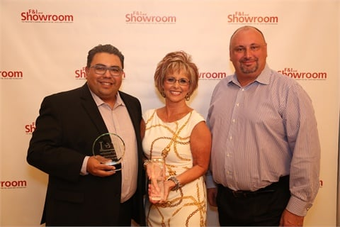 "Sue Bowman poses with F&I and Showroom's Gregory Arroyo, and Eric ""Frenchy"" Mélon, president of sales at IAS. The Sam Pack organization has been a client of the F&I product provider for more than a decade."