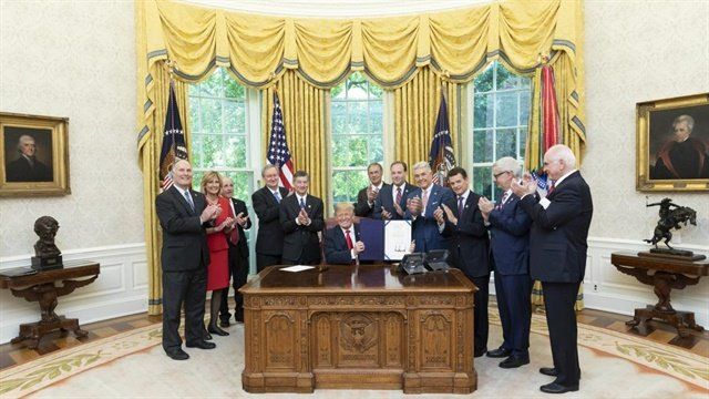 Pictured is President Trump during the May 21 signing ceremony at the White House for S.J. Res 57, the resolution of disapproval of the Consumer Financial Protection Bureau's dealer participation guidance. The signing marked the end of the industry's more than five-year battle to protect a key source of dealer income.