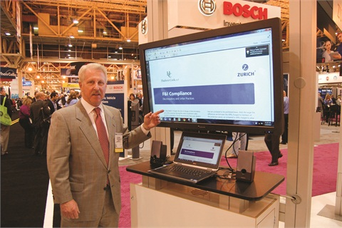 Glenn Roberts points to Zurich's new dealer compliance suite, which is designed to standardize a dealer's desking process. It includes a software-based reporting tool.
