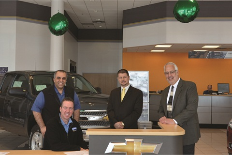 Leading Driver's Village efforts were Firas Maklouf, CIO, Mike Gould (seated above), director of sales, Dan Fiorini, vice president of Centurion Automotive Products, and Lou Bregou, director of operations.