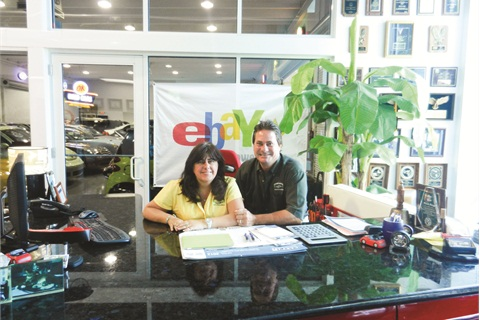 Gina and Frank Fuzy's dealership attracts customers from across the country who learn about the store on eBay Motors.
