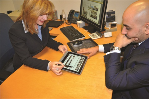 Rosa Quintero and Leandro Guidi of Mercedes-Benz of Coral Gables demonstrate Dealertrack's eMenu in the F&I office.