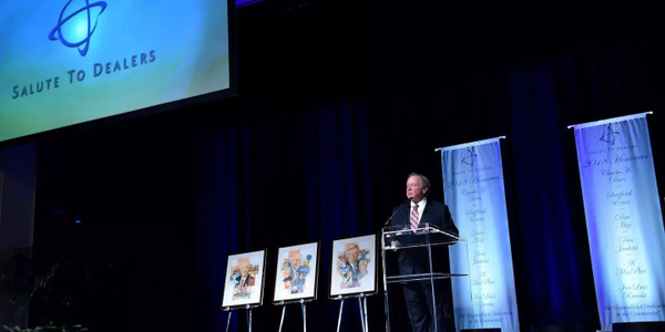 Edsel B. Ford II, who chairs the Salute to Dealers awards program, speaks during this year's...