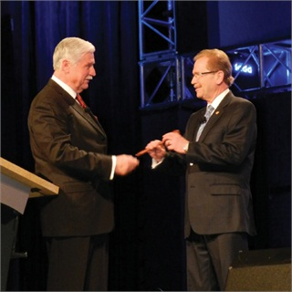 Handing the gavel over to the 2012 NADA chairman is Stephen Wade, the outgoing chairman. Regarding factory image programs, Wade said the industry must tone down the rhetoric.