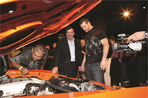 Ziegler is no a fan of GM's Interim Marketing Chief Alan Batey, who is shown here taking a look under the hood of UFC middleweight title contender Nate Markquardt's supercharged 1970 Chevelle.