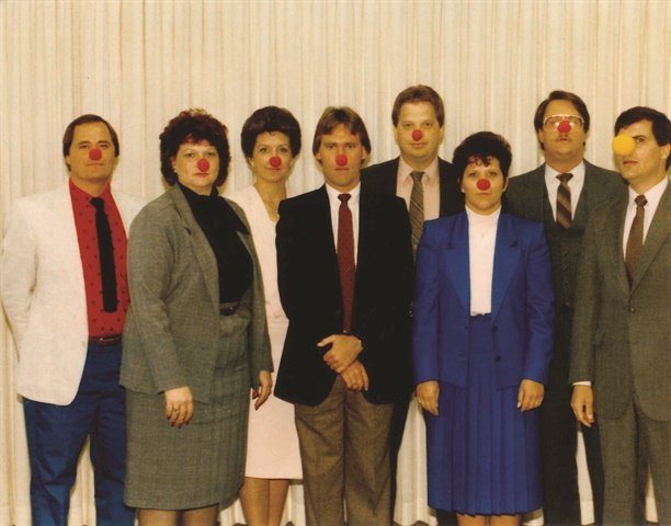 To the right is a photo Ron Reahard's 1986 F&I class. David Ressler, standing to the left in his red, white and blue suit, purchased clown noses for the occasion. Reahard can be seen standing to the far right wearing a yellow clown nose.