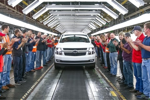 Workers at General Motors' Arlington, Texas, assembly plant applaud as the OEM's 11 millionth vehicle, a 2018 Chevrolet Tahoe, rolls off the line. A study commissioned by GM BuyPower Card found that 33.2% of U.S. drivers want to buy a new car or truck this year. Photo courtesy General Motors Co.