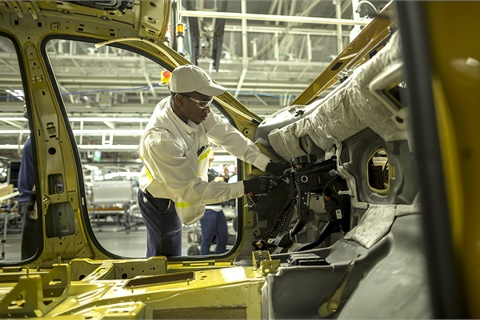A worker at Volkswagen's Chattanooga, Tenn., plant installs components on an Atlas SUV. Cox Automotive analysts predict the German automaker's U.S. new-vehicle sales will enjoy an industry-best 14.8% year-over-year increase in May. Photo courtesy Volkswagen of America Inc.
