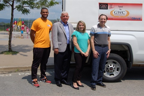 From left to right, Commission on Economic Opportunity staffer Rasheed Moore was joined by CEO Executive Director Gene Brady, Kim Konopka, CEO's Food 4 Kids summer program manager, and Rob Glander, president and CEO of GWC Warranty. Photo courtesy GWC Warranty
