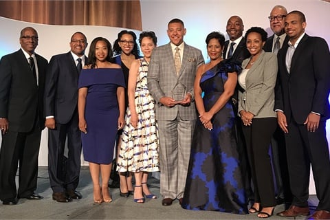 Monte Perkins II (center) celebrates winning the 2018 Cox Automotive NAMAD Rising Star Award with NAMAD President Damon Lester, NAMAD Chairman Irving Matthews, the Cox Automotive team, and Perkins' family. Photo courtesy Cox Automotive
