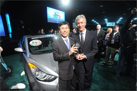 Sung Hyun Park, president of Hyundai R&D Division, and John Krafcik, president and CEO of Hyundai Motor America, accept the 2012 North American Car of the Year trophy for the Hyundai Elantra.