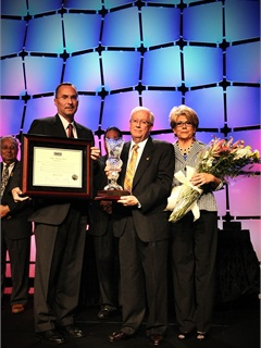 Michael Linn receives NIADA's first lifetime achievement award at the National Leadership Awards Banquet during the annual NIADA Convention and Expo.