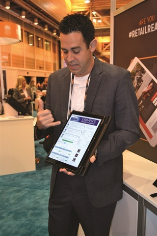 Darwin CMO Jeff Stafford demonstrates the company's F&I platform at the 2017 NADA Convention & Expo this past January.
