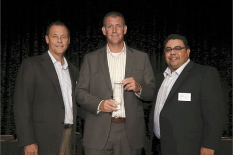 David-Moore Automotive's Sean Tarbell accepts the 2015 award from The Warranty Group's Ash Bauer and F&I and Showroom's Gregory Arroyo.