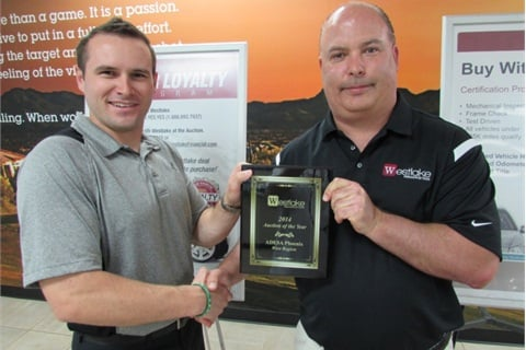 "Westlake Auction Rep Steve Gunsberger (left) presents the ""2014 Auction of the Year"" award to ADESA Phoenix fleet lease manager, Bobby Cade (right)."