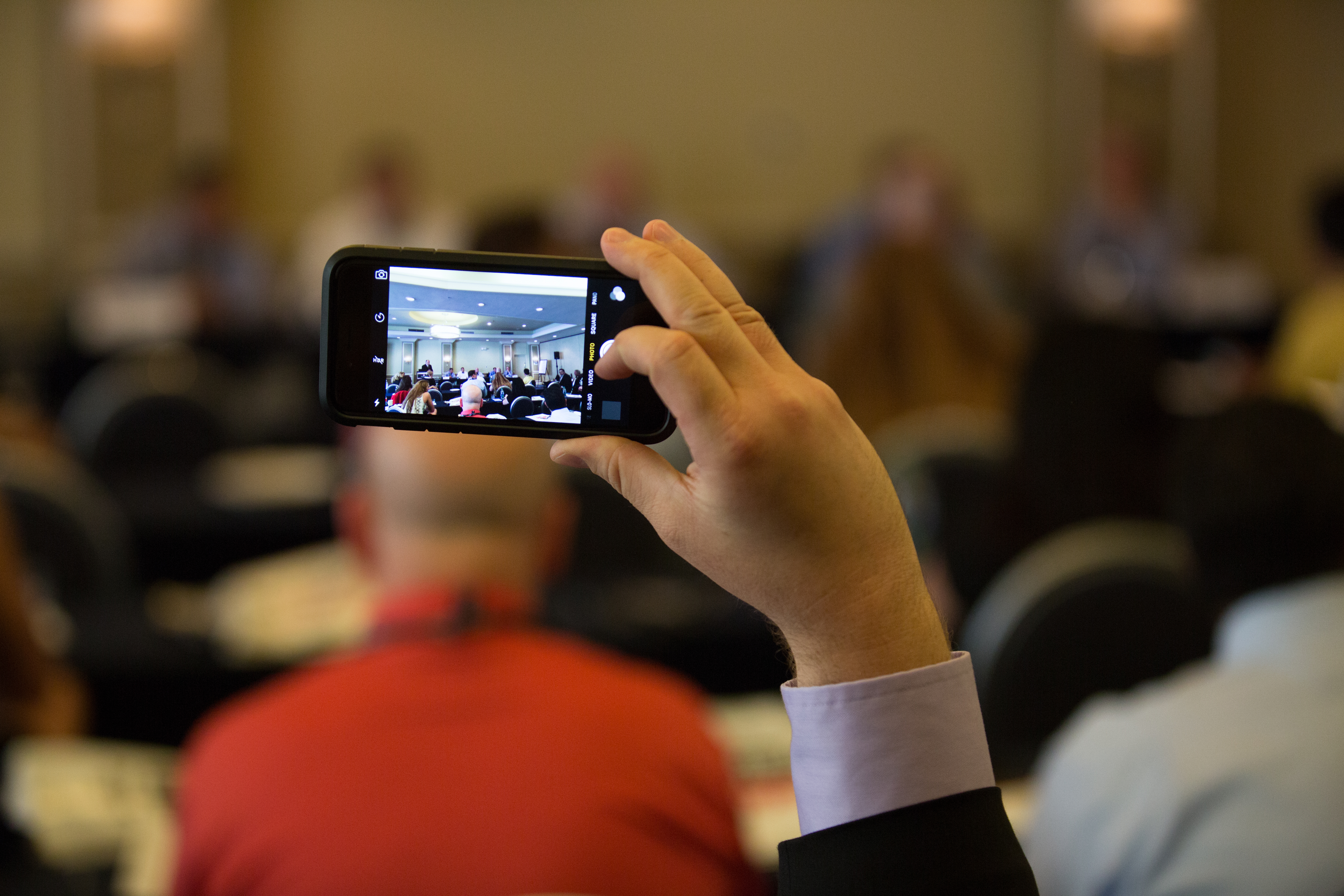Attendees would often take out their phones to record or take pictures of the panels throughout...