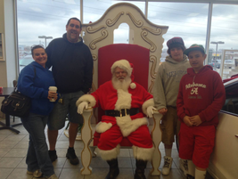 Santa meets and greets with customers of Gossett Kia in Memphis.