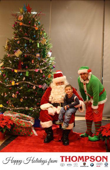Santa and his elf pose at Audi Warrington.