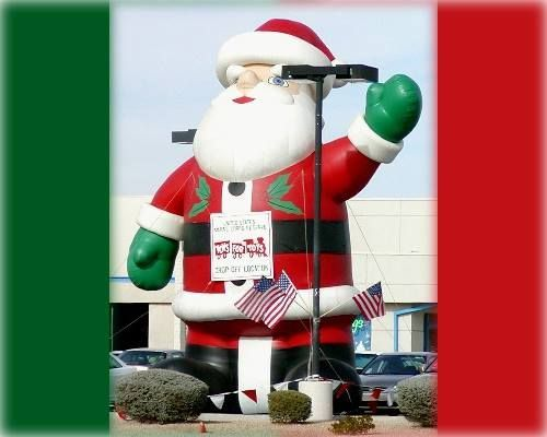 Kelly Nissan of Peabody is drawing in shoppers with the jolly Old Saint Nick.