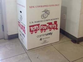 Manhattan Jeep Chrysler Dodge is collecting donations for Toys for Tots.