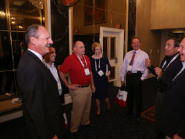 F&I and Showroom columnist Marv Eleazer (far left) chats with conference attendees, including...