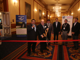 F&I and Showroom's Editorial Director Gregory Arroyo and Publisher David Gesualdo cut the ribbon...