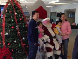Toyota Santa Monica customers pose with Santa.