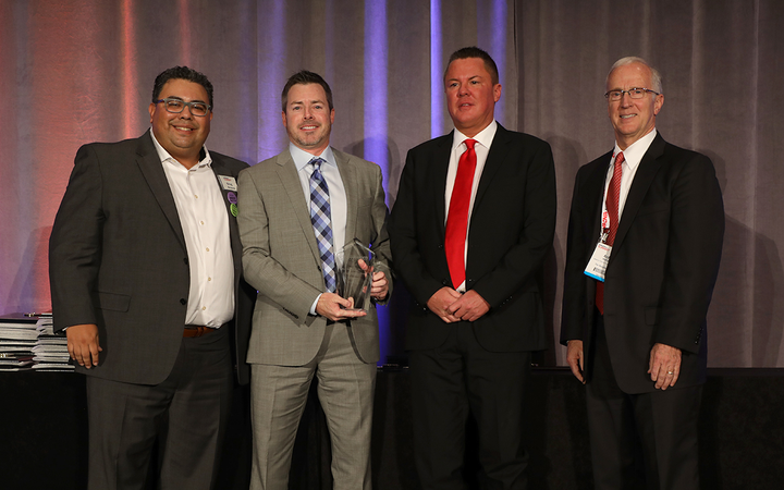 Vice President Jay Prince and F&I Director Brad Richardson are flanked by then-F&I and Showroom editor Gregory Arroyo and Arden Hetland, president and CEO of American Financial & Automotive Systems, after being named F&I Dealer of the Year for 2018. 